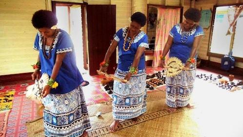 Women in traditional costumes dancing in Fiji