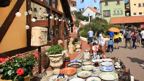 town scene with pottery and wandering people