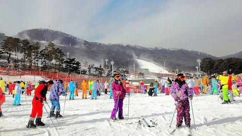 Colorfully dressed skiers at a resort in South Korea