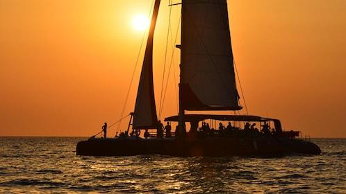 People viewing sunset on catamaran in Santorini