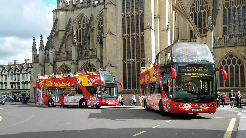 Show item 3 of 10. Pair of Hop-On Hop-Off buses in Bath