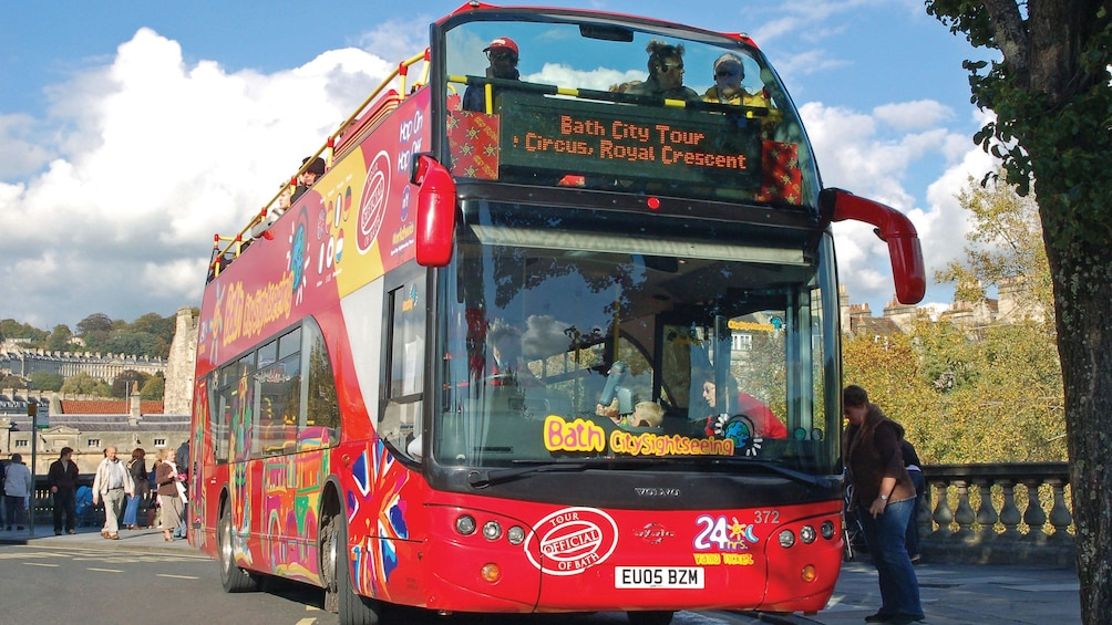Show item 10 of 10. Hop-On Hop-Off bus on a bridge in Bath