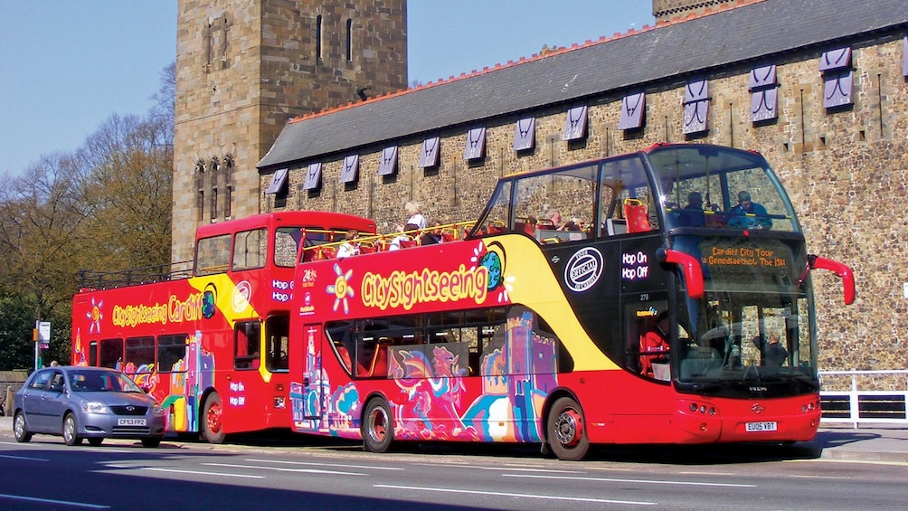 Show item 1 of 10. two red double decked bus in Cardiff
