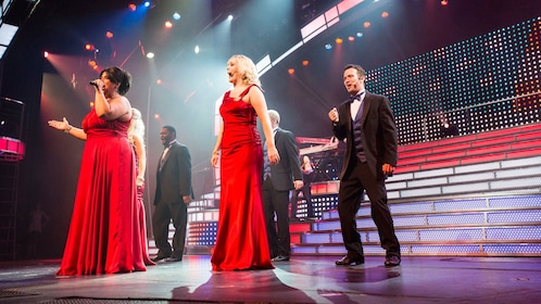 Women in red dresses and men in tuxedo at the Smoky Mountain Opry