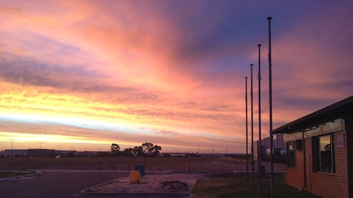 Colorful sunset near helicopter runway.
