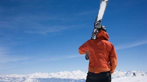 Skier holding skis on a mountain in Salt Lake City