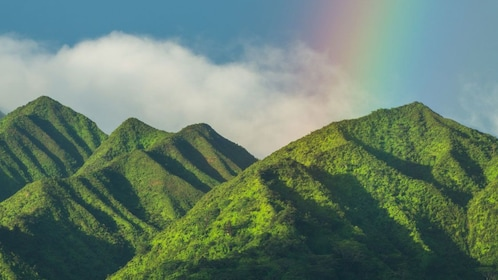 green mountains and rainbows