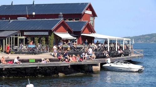People enjoying the enjoy on pier in Stockholm