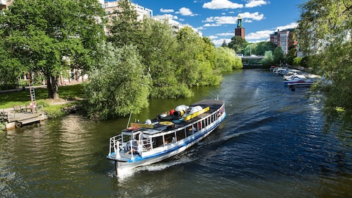 Tour boat traveling down river in Stockholm