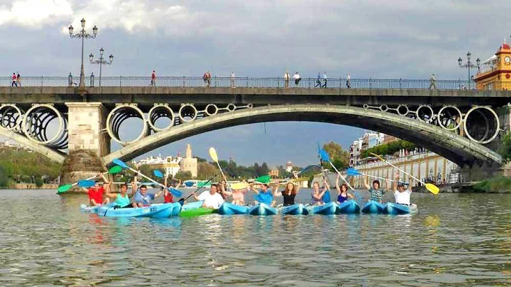 group of kayakers under a bridge in Spain