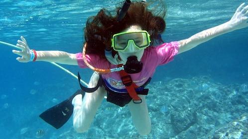 A young woman SNUBA diving in Bermuda