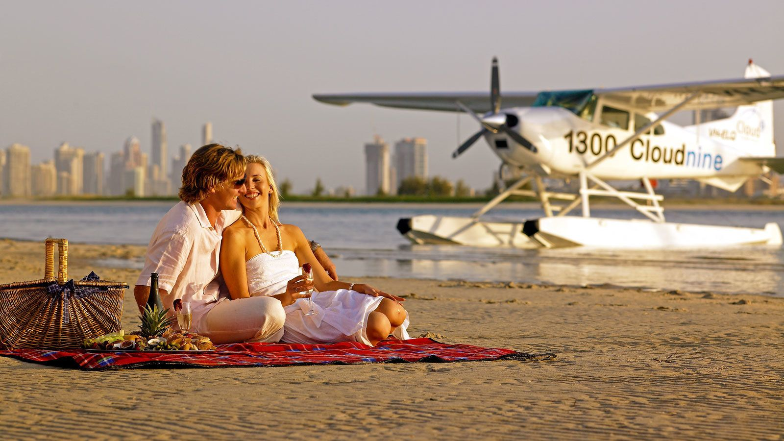 a romantic picnic at the beachside near the seaplane in Australia