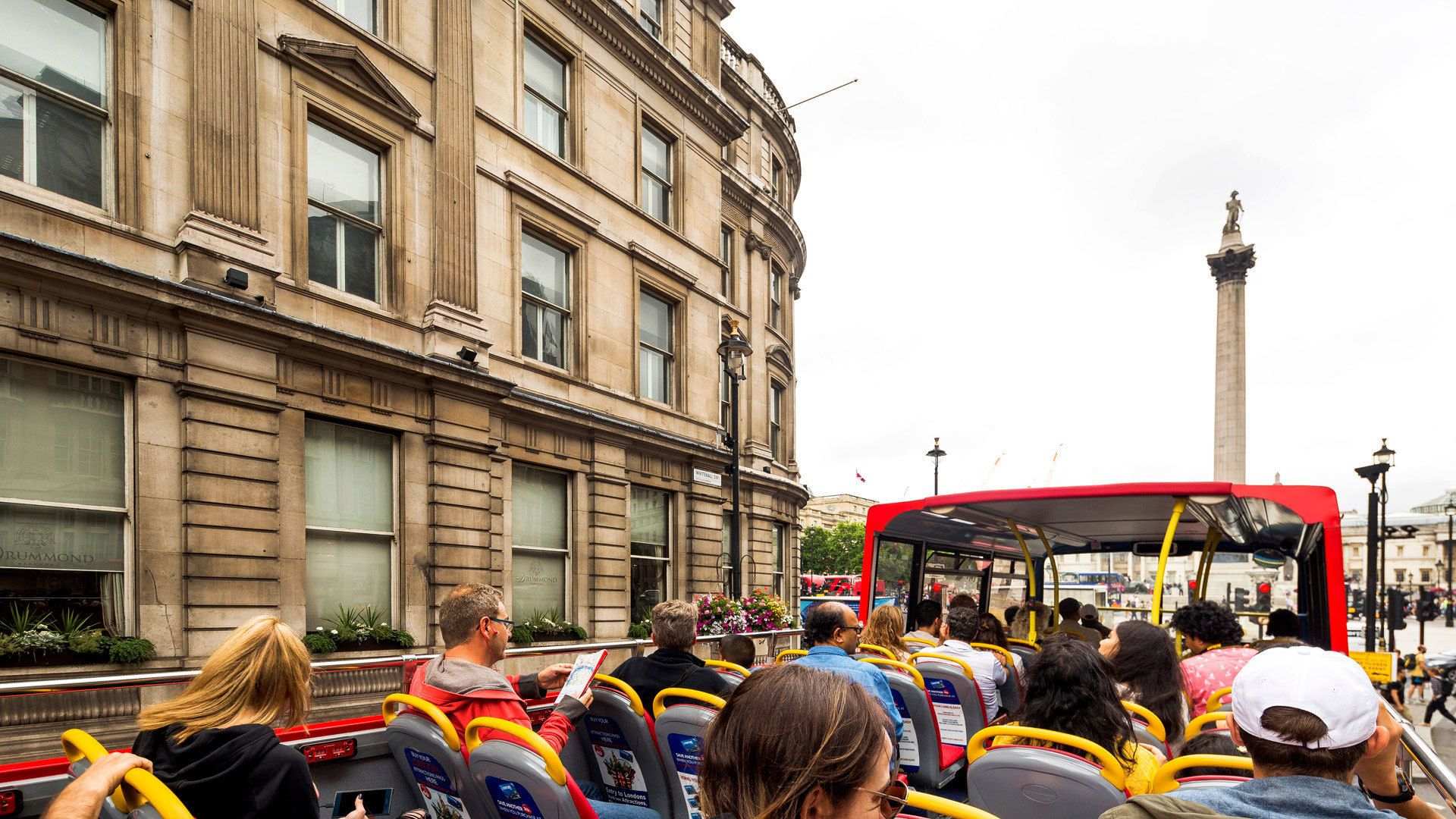 People on double decker tour bus in London