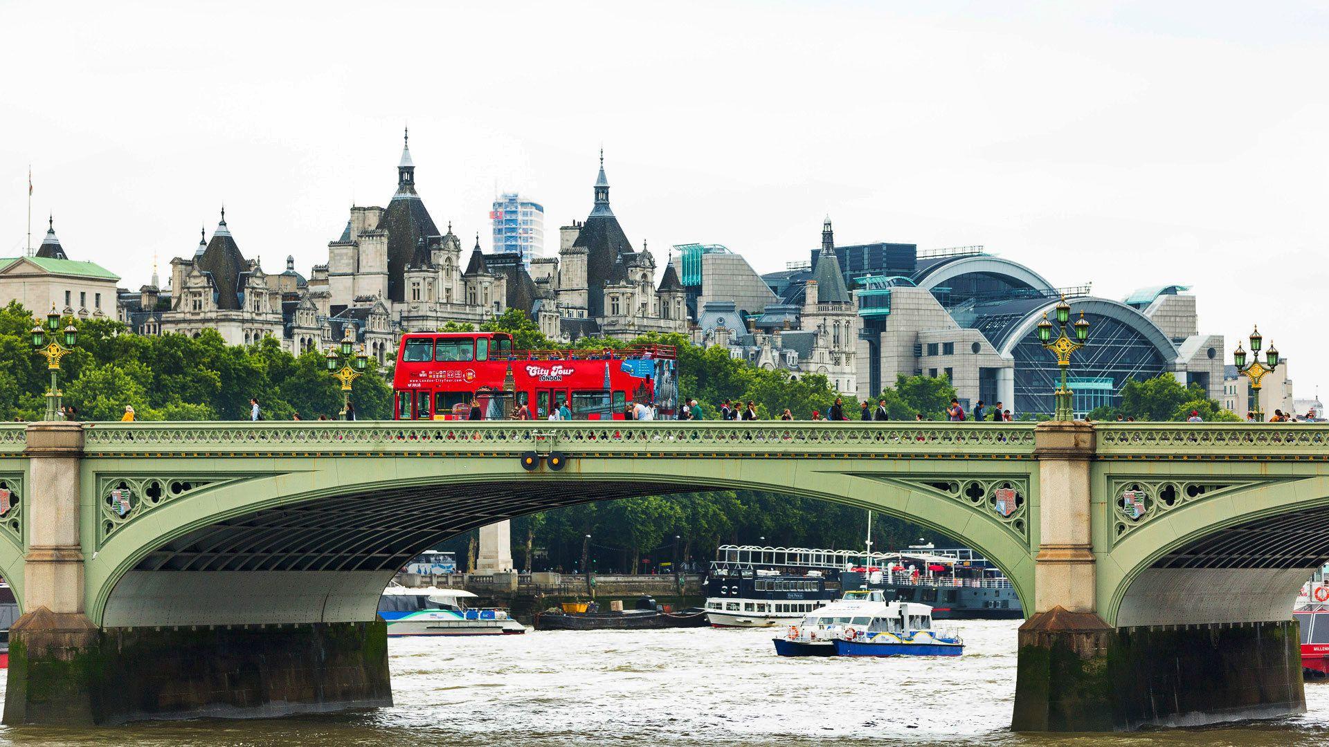 View of double decker tour bus on bridge in London