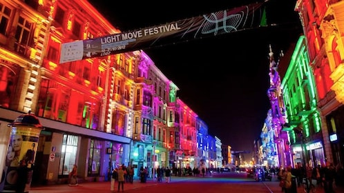 City lit up with colorful lights at night during a festival in Lodz