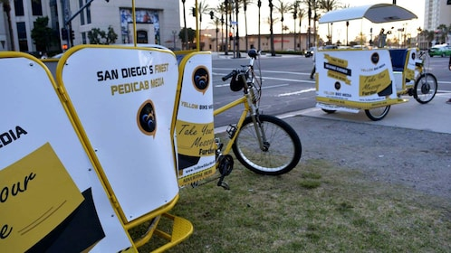 Pair of pedicabs parked along the street in San Diego