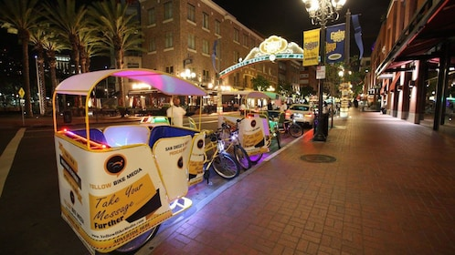 Pedicabs parked at night in San Diego