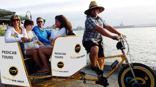 Tour group in a pedicab along the coast in San Diego