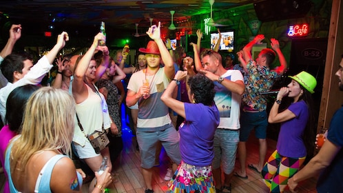 People partying at during pub crawl in Aruba