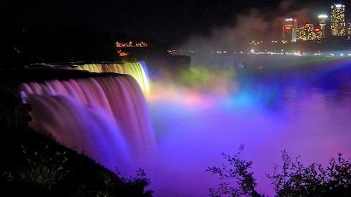 colorful illuminated water fall at Niagara Falls