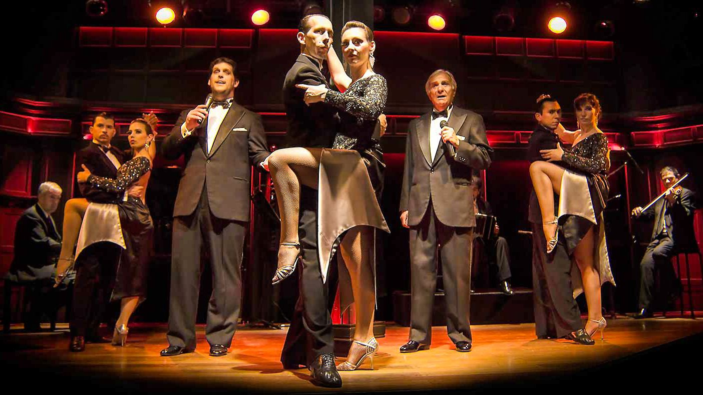 Tango dancers performing on stage.