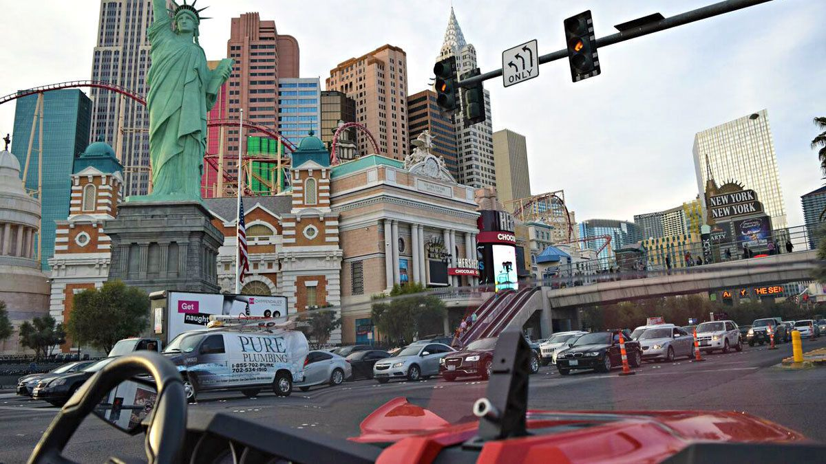 riding on a two seated vehicle around Las Vegas