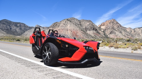 View of Slingshot car parked on road.