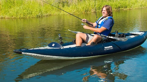 Man fishes on inflatable kayak
