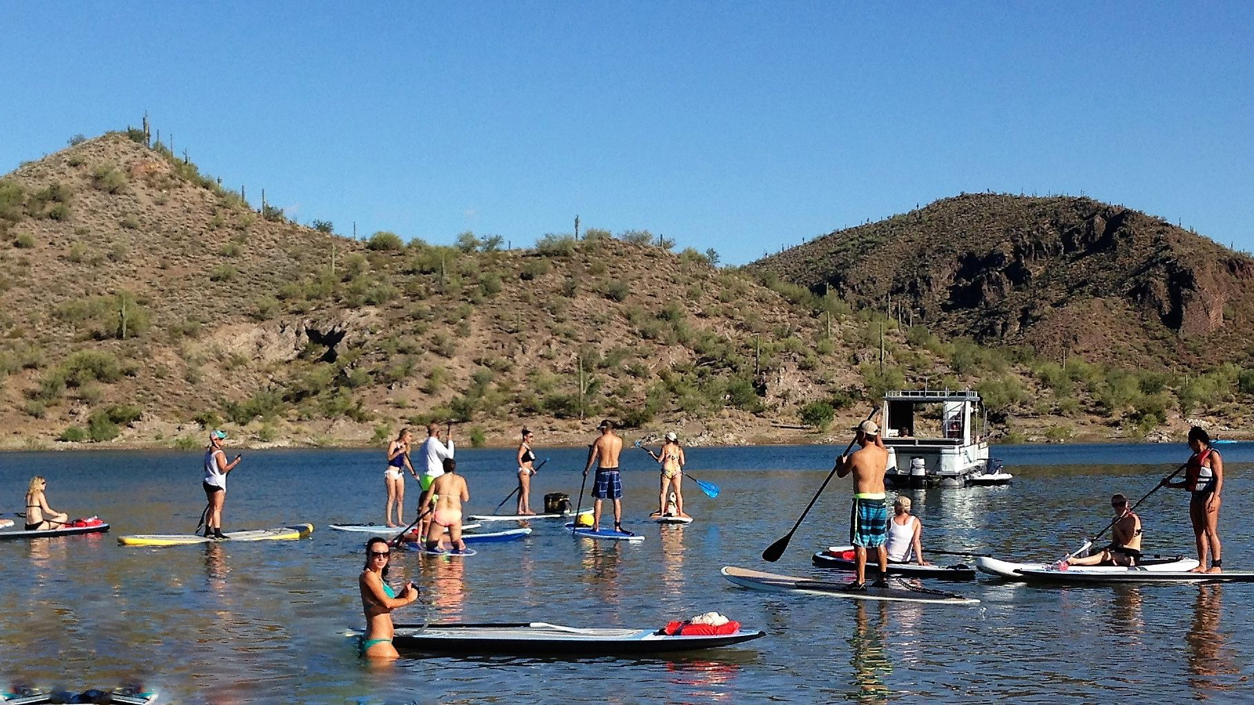 A group of paddle boarders on a lake