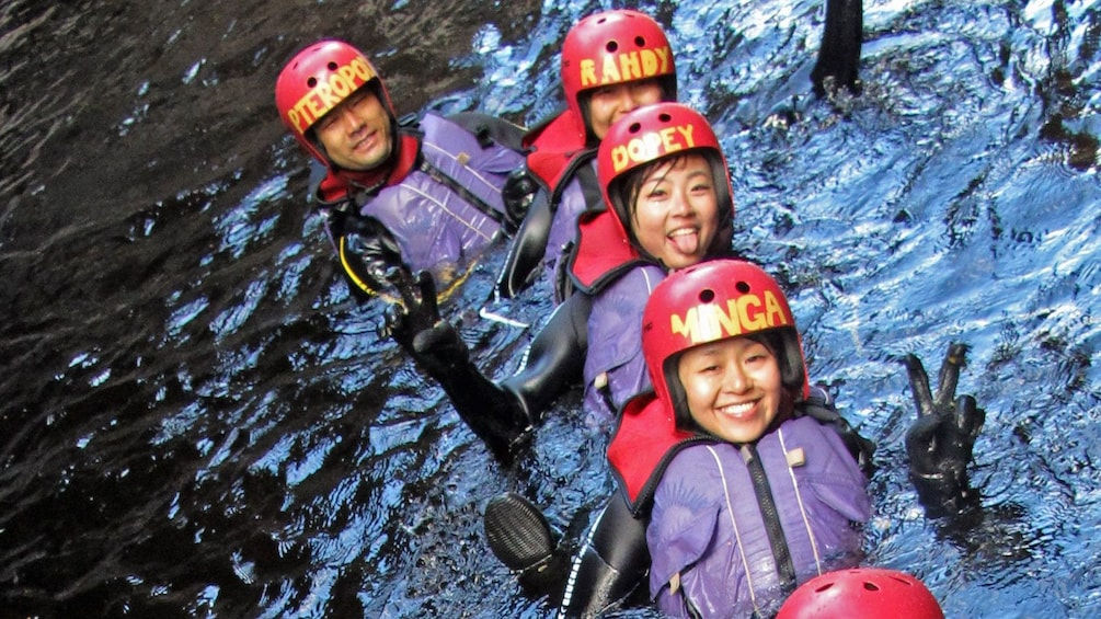 Show item 3 of 9. Group having fun on the Cradle Mountain Canyoneering Experience