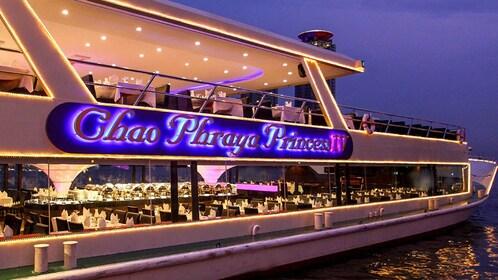 Angled view of cruise boat illuminated at night.