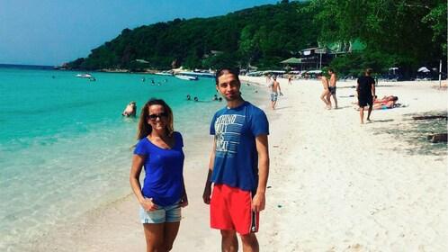 Couple on a beach on Coral Island