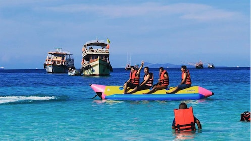 People on a watercraft on Coral Island