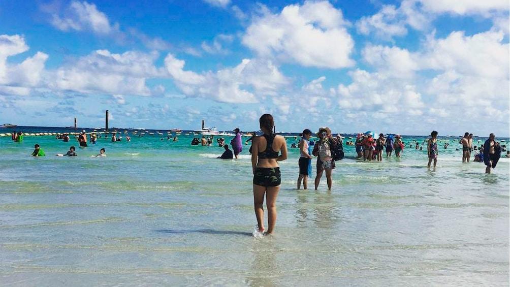 Show item 5 of 5. Beachgoers on Coral Island