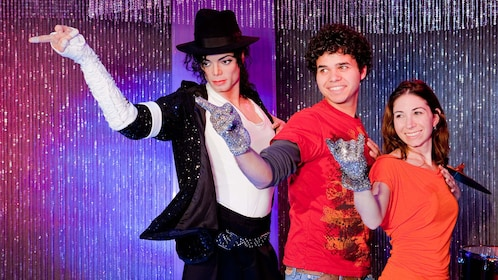 Group next to a wax sculpture of Michael Jackson at Madame Tussaud's Bangkok