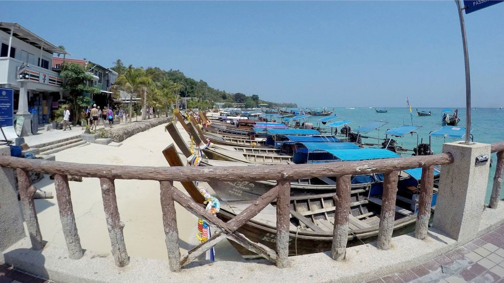 Show item 2 of 5. Boats on a sandy beach on Phi Phi Island
