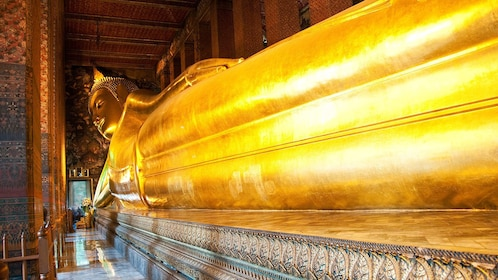 a giant statue of a laying Buddha at a temple in Bangkok