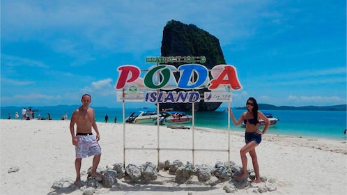 Couple on the beach on Poda Island