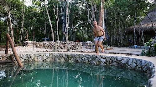 Man about to jump into a pool