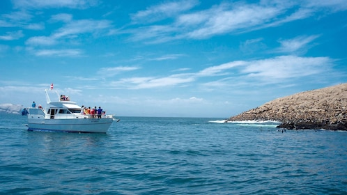 Tour boat off the coast of the Palomino Islands in Peru