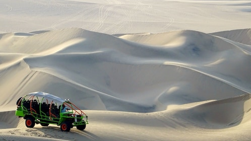 Large group dune buggy on the rolling desert hills in Lima