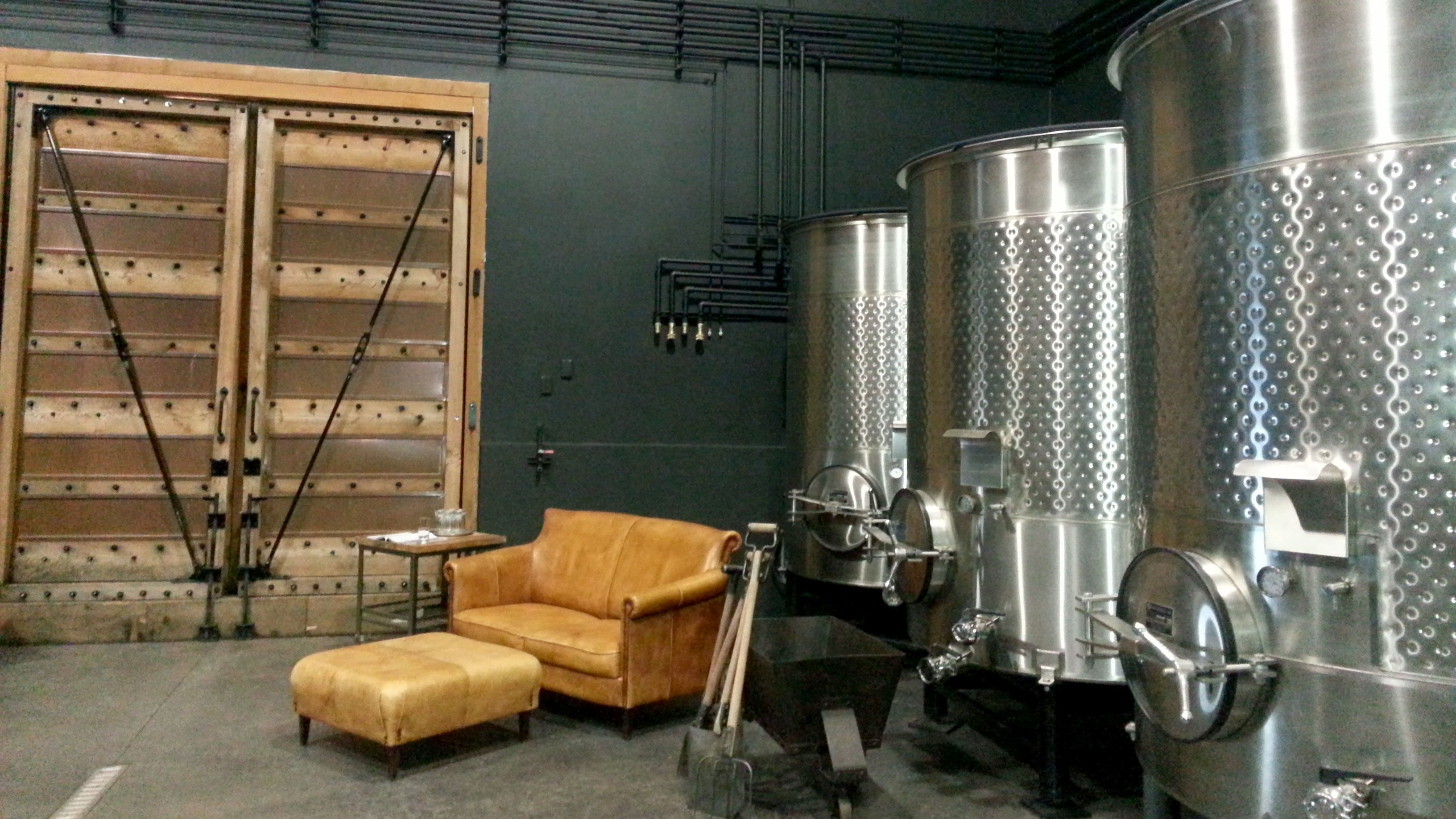 Large vats and seating inside a winery in Portland