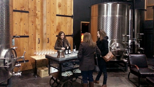 Women with sommelier pouring wine inside a winery in Portland