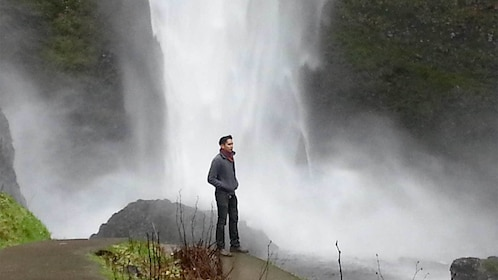 Man enjoying the view of the Multnomah Falls in Portland