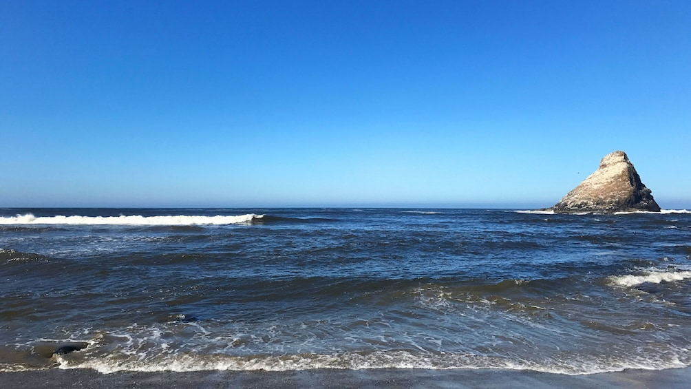 Waves rolling in at beach in Oregon