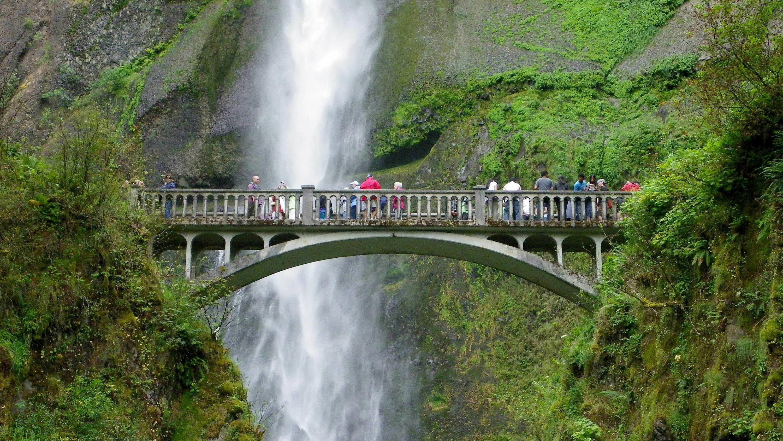 Tourists visiting Multnomah Falls in Portland, Oregon