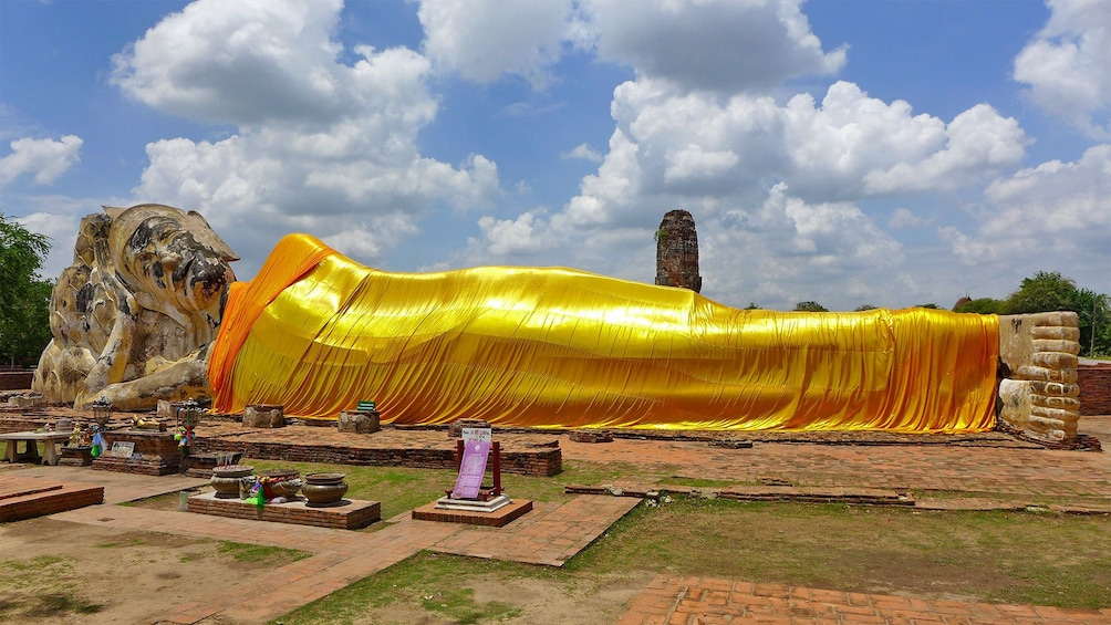Show item 2 of 8. Gold reclining Buddha statue in Bangkok