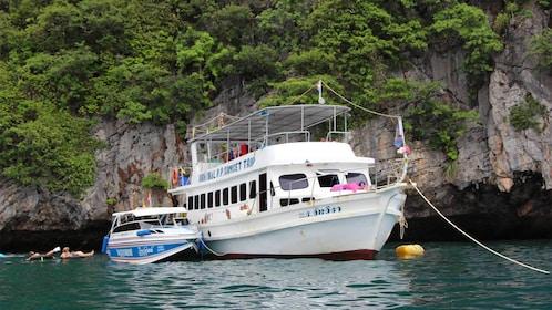 Tourists enjoying the Phi Phi Island tour in Phuket, Thailand