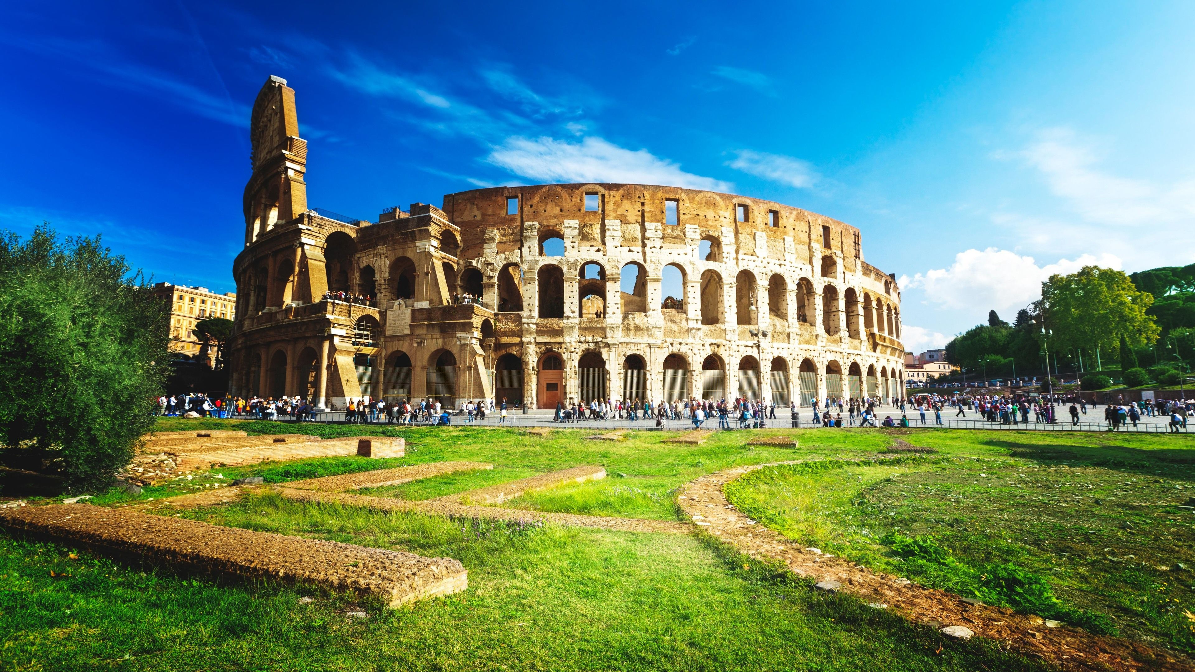 Vibrant landscape view of colosseum during the day.