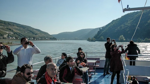 Cruising group taking photos from the boat on the Rhine River